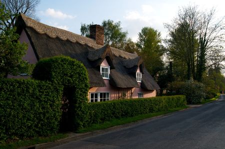 An english thatched cottage in the countryside photo