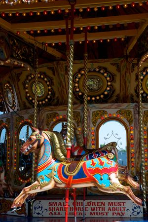 A colourful carousel, roundabout or merry go round wooden horse Stock Photo - 7109796