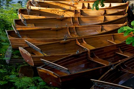 lake district england: rowing boats tied up in Dedham in Constable Country, England