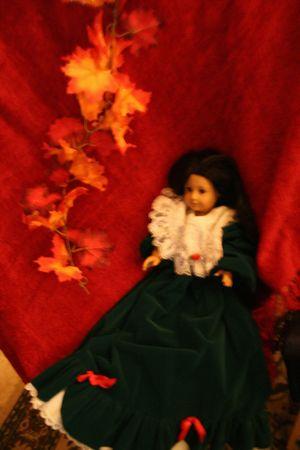 velvet dress: Victorian Era dressed Doll Stock Photo