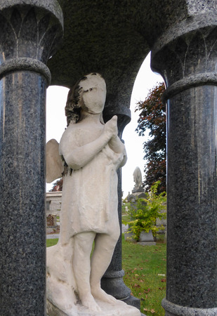 angel headstone: White blind statue at cemetery Stock Photo