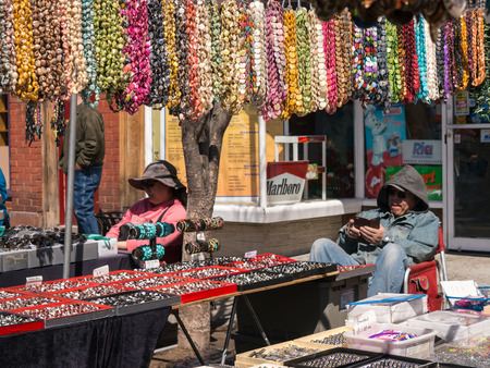 trinkets: NYACK, NY - APRIL12: Stallholders with glasses and trinkets at Spring Festival April 12, 2015 in Nyack NY