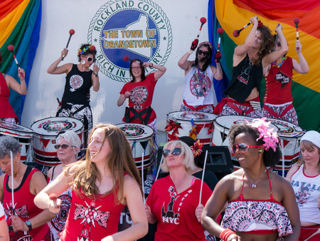women only: Nyack NY USA  June 14 2015: Members of Batala NYC women only band performing on and before the stage during Rockland County Pride.