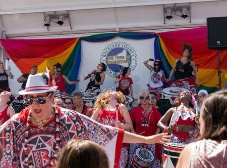 women only: Nyack NY USA  June 14 2015: Members of Batala NYC women only band performing on and before the stage during Rockland County Pride. women only band with leader on the front performing before the stage during Rockland County Pride.
