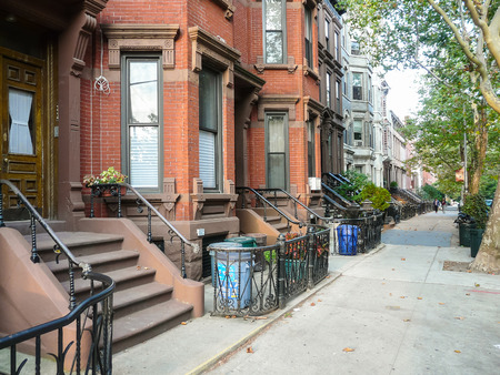 portals: Brooklyn, New York - August 16, 2014: Stairs and portals of residential brick houses at Kent Street in Greenpoint.