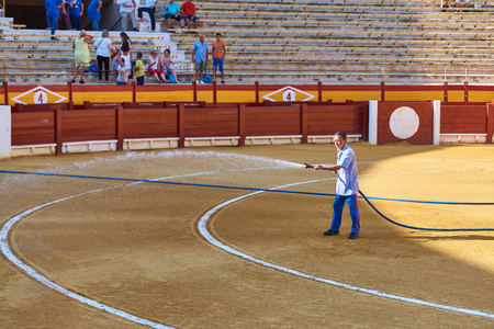 Alicante / Spain - 08 03 2018: The worker watered the arena before the bullfight
