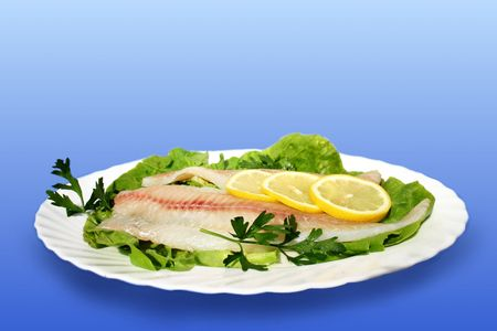 raw fish on white plate photo
