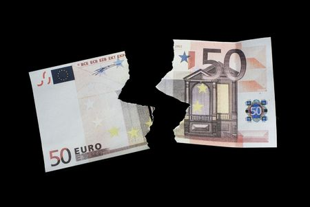 torn note fifty euro on black background