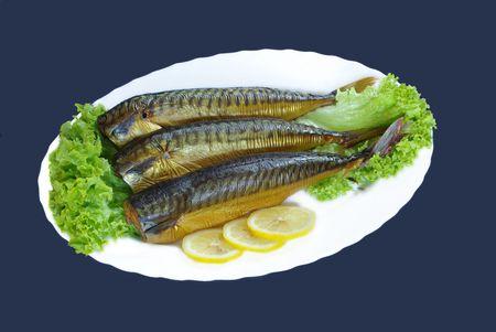 kipper: smoked mackerels from lettuce on white plate