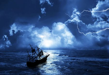the sailing-ship in time of storm from lightnings photo