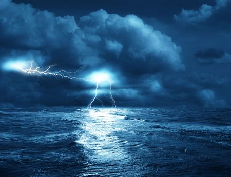 the storm on sea from lightnings on background of clouds photo