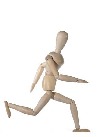running wooden dummy on white background photo