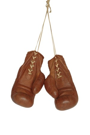 old boxing gloves on white background photo