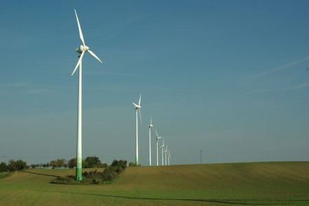 wind turbine on blue sky background photo