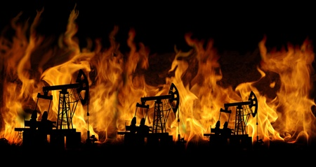 oil exploration: oil pumps on fire background