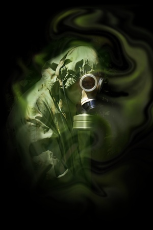 chemical warfare: the man in anti-gas mask in vapours of gas