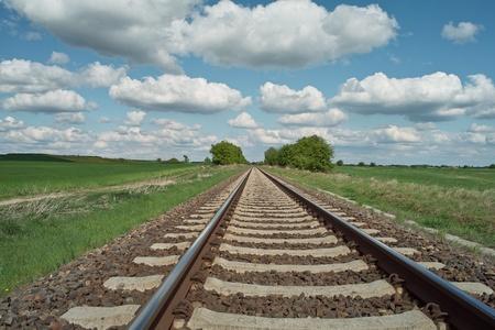 sun track: railway tracks on background of scenery Stock Photo