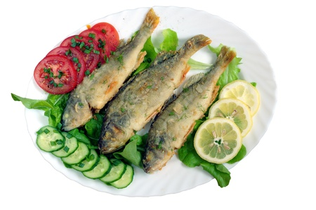 british foods: fried fish with vegetables on white plate