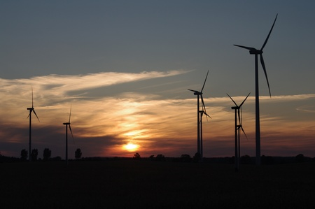 wind turbine on sunset background photo