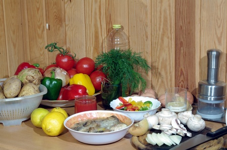 components of dinner on vegetable background photo