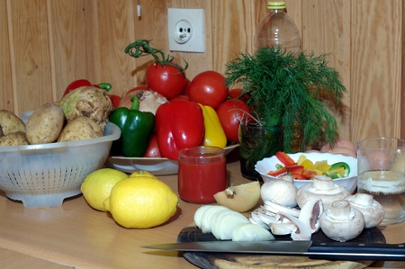 fragment of kitchen with vegetables photo