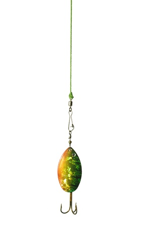 metal angling bait on white background photo