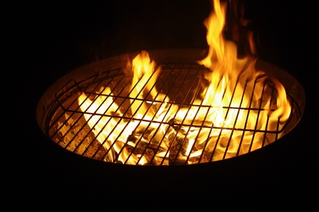 grill in night from flames Stock Photo