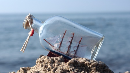 sailcloth ship in closed with cork bottle