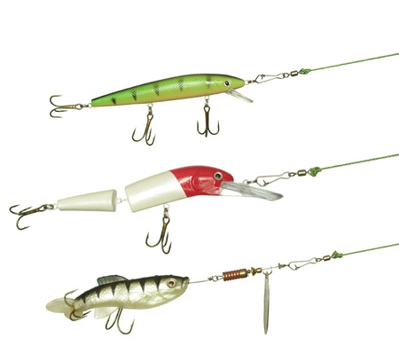 three wobbler for fishing on white background photo