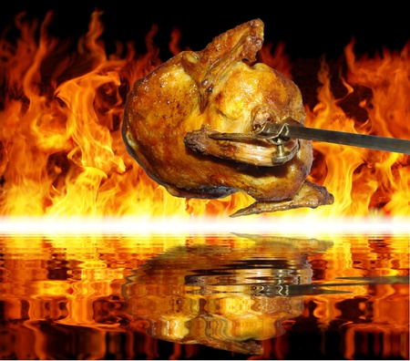 chicken on grill on background of flames Stock Photo - 10865145