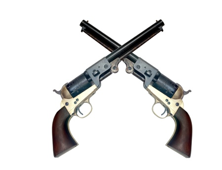 six shooter: two old metal colt revolver on white background
