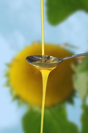 casts  oil on spoon on sunflower photo