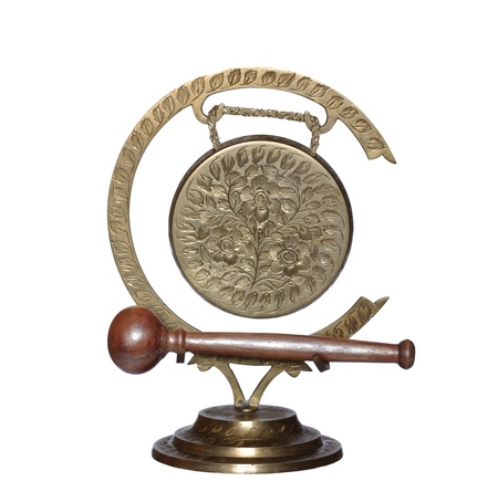 exotic gleam: old metal gong on white background