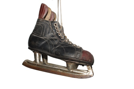 old hockey skates on white background