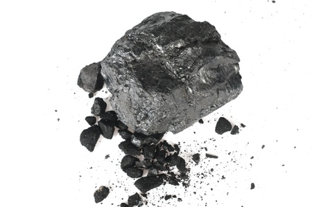 the piece of carbon and the crumbs on white background photo