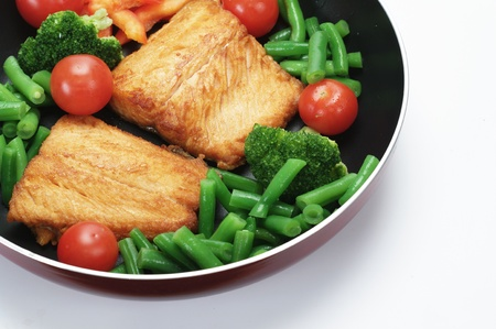 fried salmon with vegetables   on white background