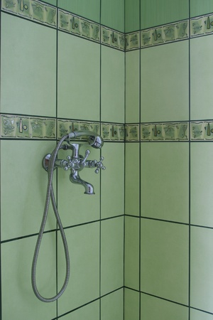 fragment of bathroom with green glaze photo
