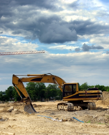 excavator on place of building photo