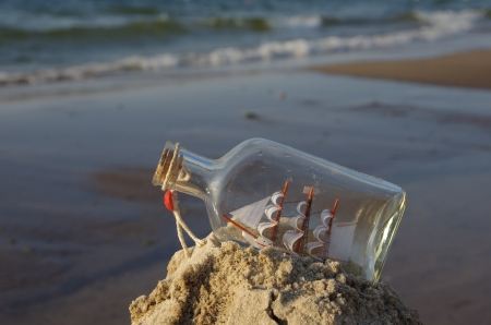 trinket: sailcloth ship in closed with cork bottle