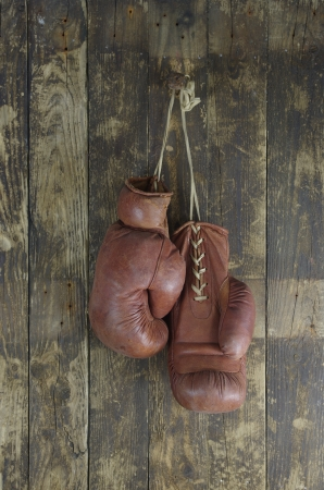 old boxing pendant on peg gloves Stock Photo