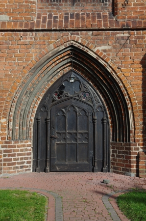 old wodden gothic gate photo