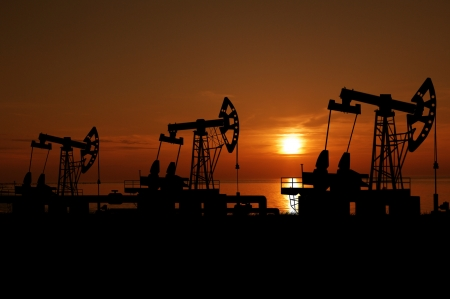 counterweight: Illustration of oilfield with pump on sunset background