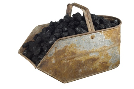 dredging tools: old bucket with carbon on white background