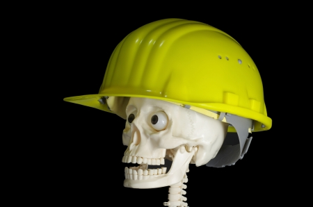 skull in protective helmet on black background photo