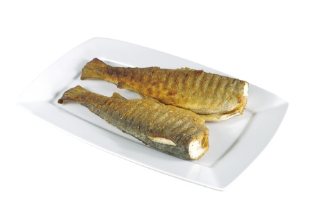 two baked trout on white  plate  photo