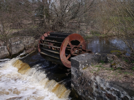 inoperative: old inoperative water mill on river background Stock Photo