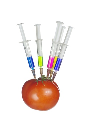 Injection into fresh red tomato on white background photo