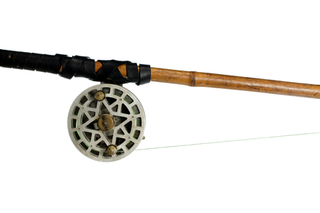 fishing-rod with old spinning-wheel on white background Stock Photo - 22969180