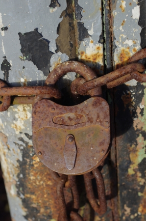 rusty  padlock with old metal chain photo