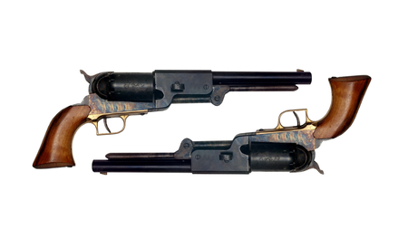 two identical old metal colt revolver on white background photo